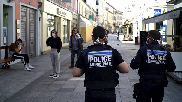 Municipal police officers patrol in a street of Sceaux during nationwide confinement measures to counter the Covid-19, in Sceaux, south of Paris, Wednesday, April 8, 2020.