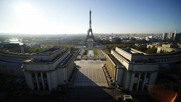 This photo taken Sunday April 5, 2020 shows the Trocadero square with the Eiffel Tower in background during the nationwide confinement due to the coronavirus outbreak in Paris