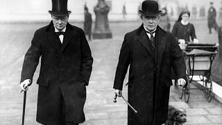 British leader of the Liberal Party David Lloyd George (R), walking next to leader of the Conservative Party Winston Churchill, in London in 1934.