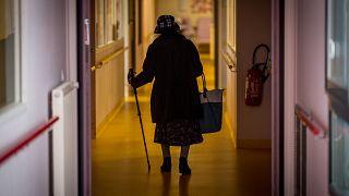 A resident walks down a corridor in Housing Establishment for Dependant Elderly People in Brest, western France