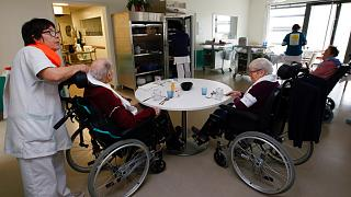 A care worker looks after residents of the Maharin nursing home of Anglet, southwestern France, Tuesday, Jan.30, 2018.