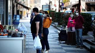 Pedestrians wear face masks in Sceaux, south of Paris,  on April 8, 2020 (Photo by THOMAS COEX / AFP)