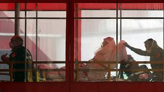 Emergency medical technicians wheel a patient into Elmhurst Hospital Center's emergency room, Tuesday, April 7, 2020