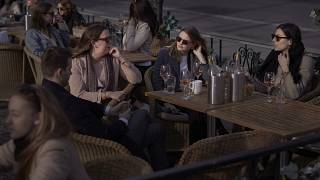 People chat and drink in Stockholm, Sweden, Wednesday, April 8, 2020.
