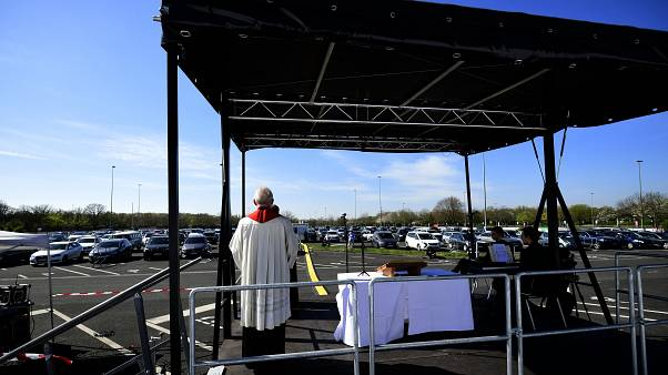 Pastor Frank Heidkamp holds an easter service under the open sky in Duesseldorf drive-in cinema, western Germany, on April 10, 2020
