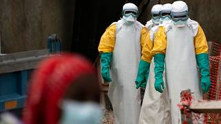 Health workers at an Ebola treatment center in Beni, Congo DRC, in 2019