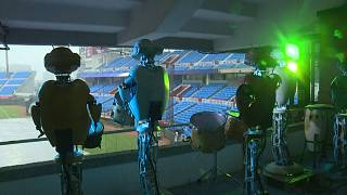 Robot drummers and posters take to the stands for Taiwan's baseball season