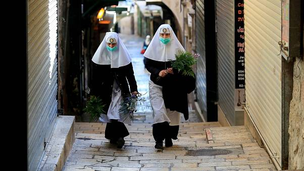 Nuns walk along the Via Dolorosa
