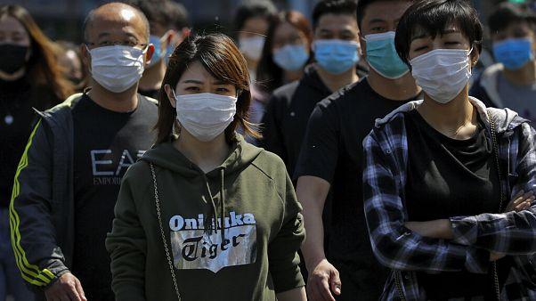 Maszkot viselnek Peking utcáin