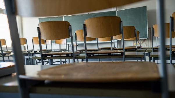 (FILES) This file photo taken on March 13, 2020 shows an empty classroom at a high school in Halle/Saale. (Photo by JENS SCHLUETER / AFP)