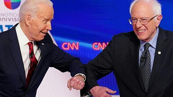 (US vice president Joe Biden (L) and Senator Bernie Sanders greet each other with a s