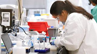 A researcher at Protein Sciences works in a lab, Thursday, March 12, 2020, in Meriden, Conn. The biotech company is currently researching a vaccine for COVID-19.