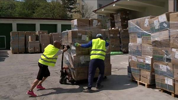 Workers unloading medical equipment at Romania's Covid Command centre