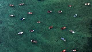 An aerial view shows fisher boats at the harbour in Sal Rei at Boa Vista island, Cape Verde, on January 06, 2020. (Photo by INA FASSBENDER / AFP)