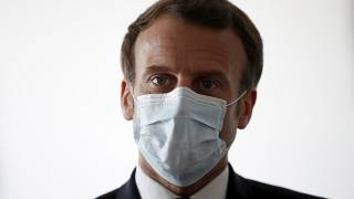 French President Emmanuel Macron wear a protective face masks as he visits a medical center in Pantin, near Paris, Tuesday April 7, 2020.