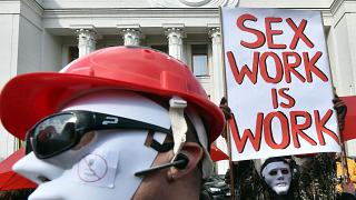 Sex workers wearing masks demonstrate in Ukraine for rights