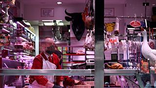 A butcher works in his shop in Paris, on April 16, 2020
