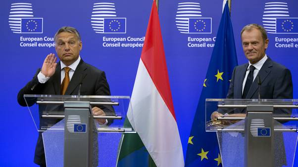 European Council President Donald Tusk, right, and Hungarian Prime Minister Viktor Orban