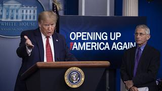 President Donald Trump with Dr Anthony Fauci, director of the National Institute of Allergy and Infectious Diseases, at the White House, Washington DC, April 16, 2020.