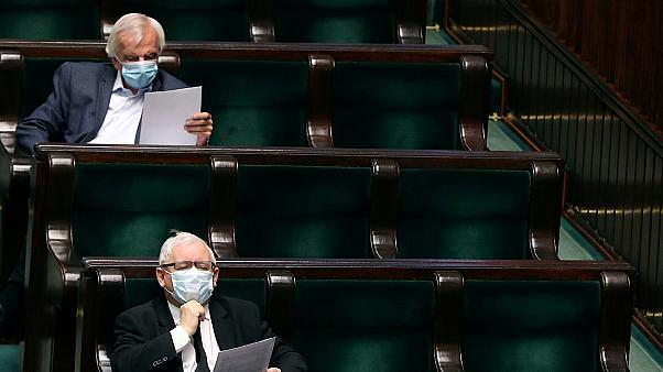 Leader of Poland's conservative ruling party, Jaroslaw Kaczynski, bottom, and prominent party member Ryszard Terlecki, top, in parliament, in Warsaw, Poland, on April 16, 2020