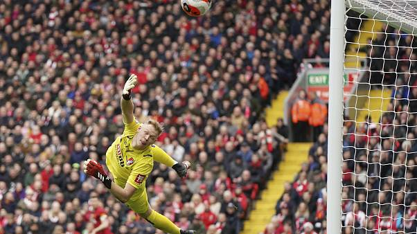 Bournemouth's goalkeeper Aaron Ramsdale saves during the English Premier League soccer match between Liverpool and Bournemouth at Anfield, Liverpool, March 7, 2020.