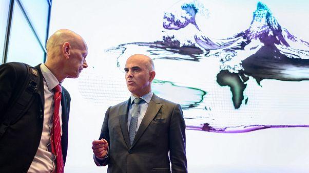 Daniel Koch of the Swiss Federal office of public health listens to Swiss Interior Minister Alain Berset