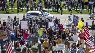 """Several hundred people attend a """"Stand for Freedom"""" rally against - and in violation of - a stay-at-home locidown order in Boise, Idaho, Friday, April 17, 2020."""