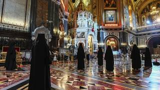 Russian Orthodox Church nuns, observe social distancing guidelines as they attend an Orthodox Easter service at Moscow's Christ the Saviour Cathedral, Sunday, April 19, 2020