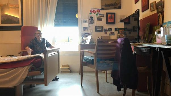 Nicole Vignault sitting in her room at the Hector Malot nursing home, Fontenay-sous-Bois, France