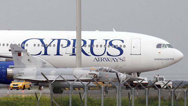 A Qatar Air Force fighter jets on the ground next of a Cyprus airways Airbus A330