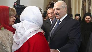 Belarusian President Alexander Lukashenko talks with believers during the Orthodox Easter service at a church in a village on the outskirts of Minsk