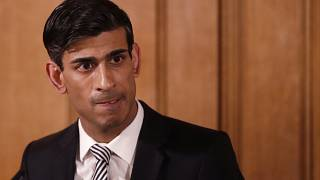 In this file photo dated Tuesday, March 17, 2020, Britain's Chancellor Rishi Sunak gives a press conference about the ongoing situation with the COVID-19