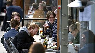 People enjoy themselves at an outdoor restaurant, amid the coronavirus outbreak, in central Stockholm, Sweden