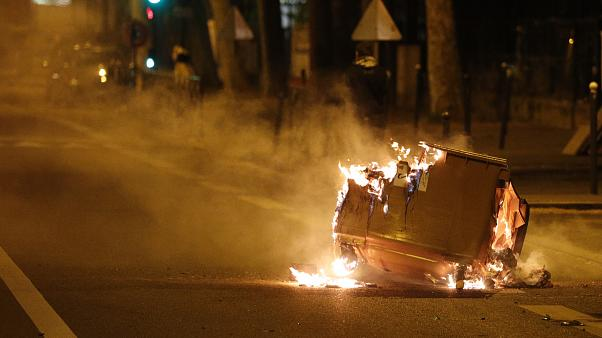 A car  burns in the street during clashes in Villeneuve-la-Garenne, in the northern suburbs of Paris, early on April 21, 2020
