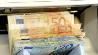 In this June 22, 2009 file picture a machine counts Euro bank notes in a counter of a bank in Dresden, Germany