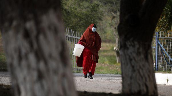 Virus Outbreak Greece Migrants