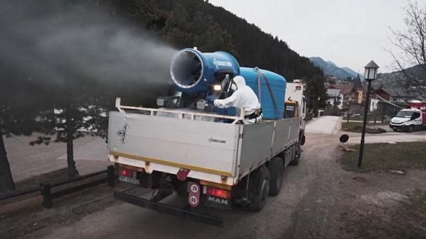 Italian towns are being disinfected with truck-mounted snow cannons