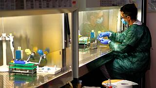 A technician works in the lab of the COVID-19 department of the Policlinic of Tor Vergata in Rome, Friday, April 17, 2020.