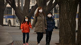 A family wear face masks in Seoul