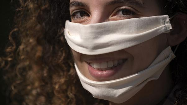 French Anissa Mekrabech, wearing the protective face mask she created for the deaf earing-impaired people