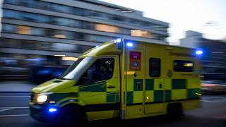 An ambulance drives past St Thomas' Hospital in central London on April 7, 2020.