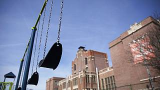 Swings sit empty on a playground outside Achievement First charter school Saturday, March 7, 2020, in Providence, Rhode Island, US