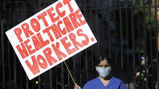 An NHS doctor protests in front of Downing Street on April 19, 2020