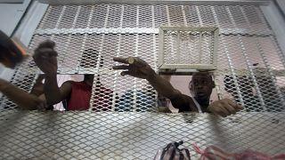 Several inmates buy supplies at Najayo jail's store in San Cristobal, May 30, 2007.
