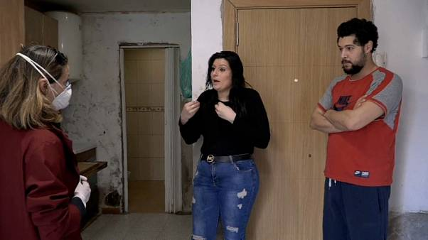 Tamara and Zakarias explaining their situation to correspondent Cristina Giner, Barcelona, Spain
