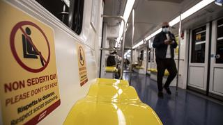 """""""Respect social distancing"""" reads a sign on Milan's metro."""