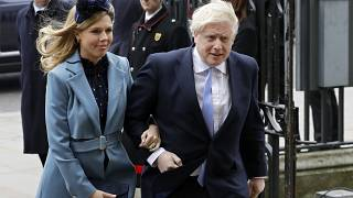 Britain's Prime Minister Boris Johnson and his partner Carrie Symonds on March 9, 2020.