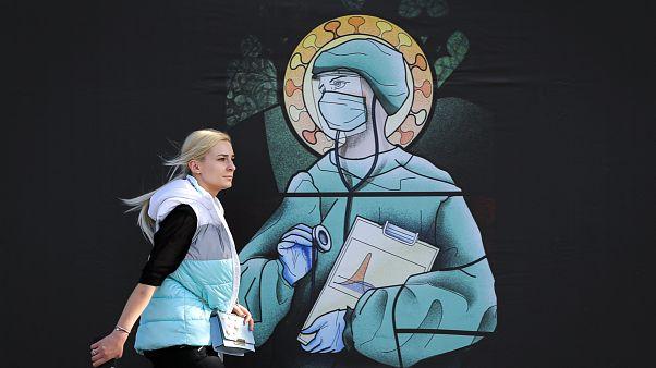 APTOPIX Virus Outbreak Romania Religion