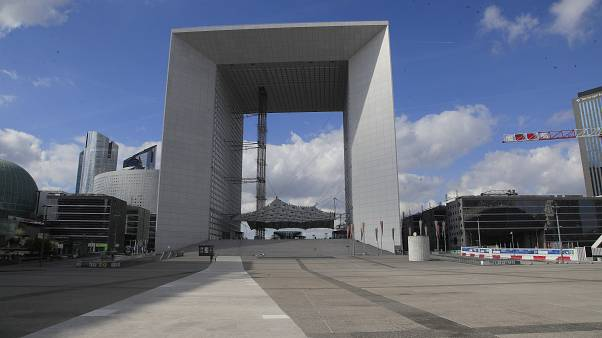 A view of the empty La Defense square in Paris, Wednesday, March 18, 2020.