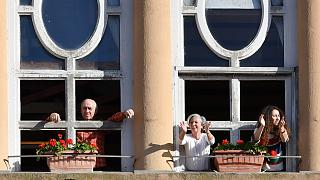 March 3, 2020. People applaud from their window in Rome to celebrate the easing of the lockdown restrictions scheduled for the following day.